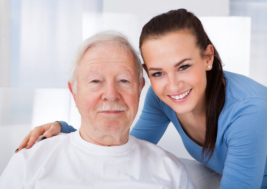 Caretaker With Senior Man At Nursing Home in Glenolden, PA