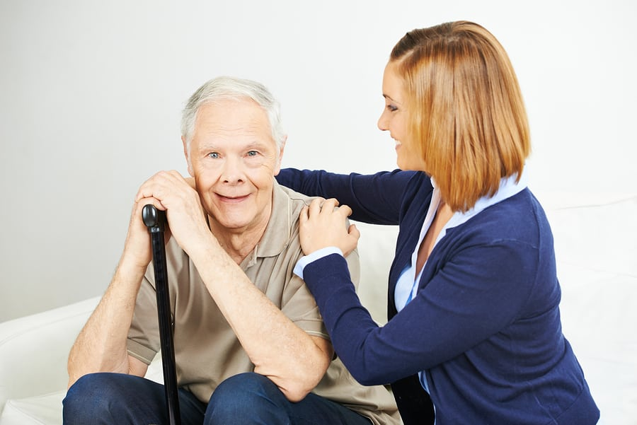 Daughter doing elderly care of senior man at home in Media, PA