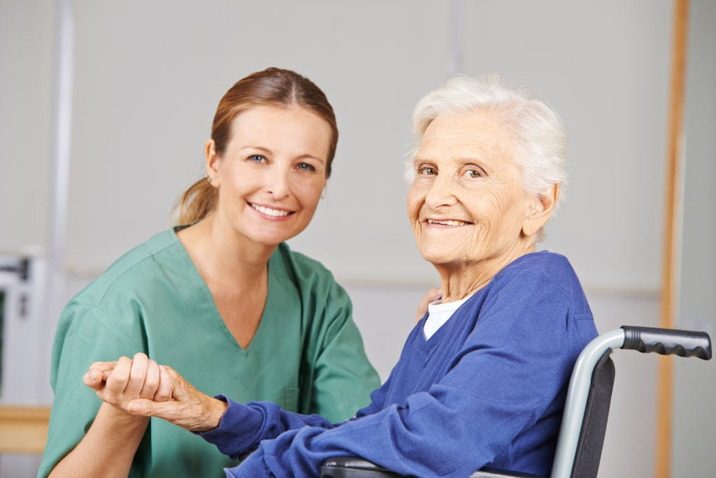 Geriatric care with nurse and happy senior woman in a wheelchair in Bryn Mawr, PA