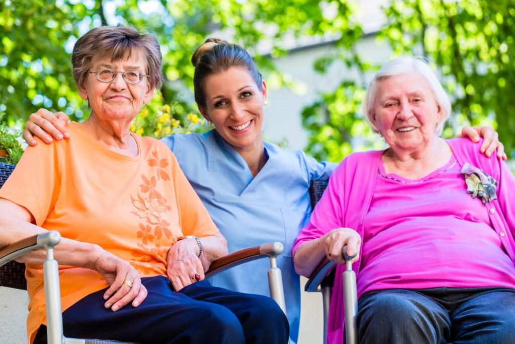 Geriatric nurse having chat with senior women in Glenolden, PA