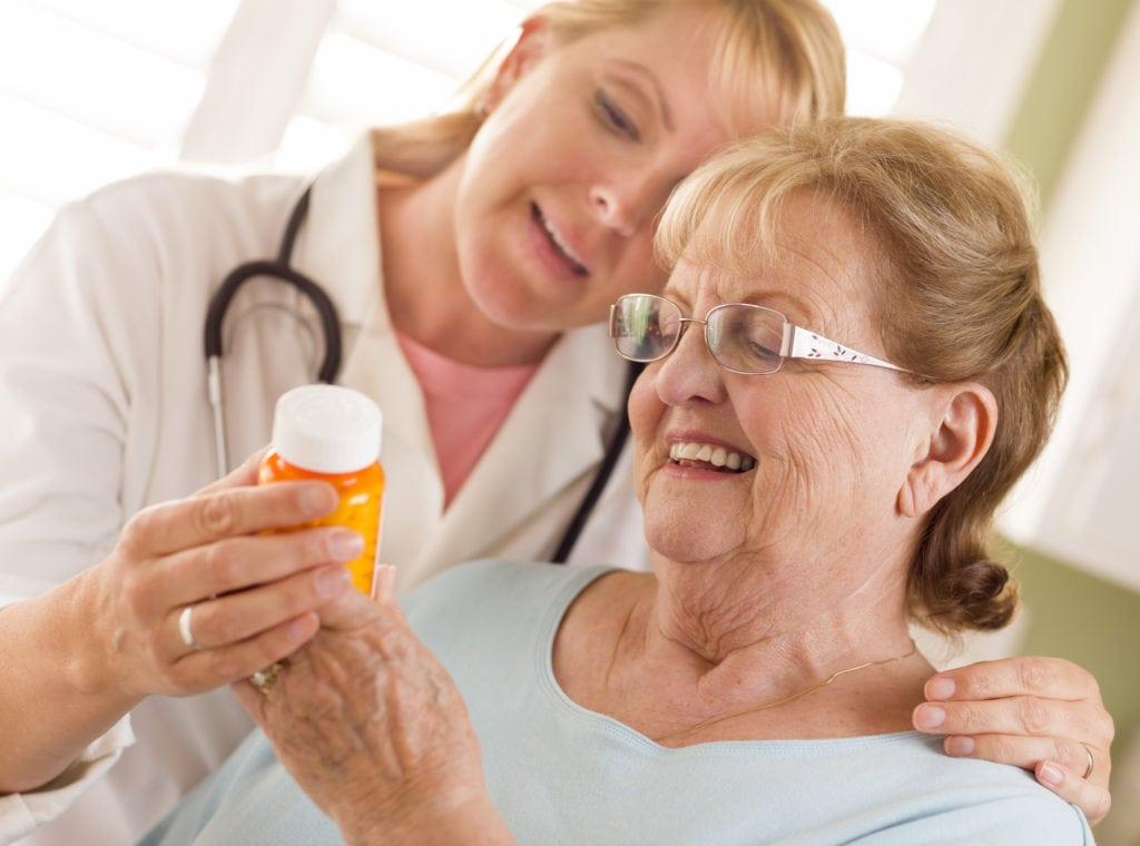 Happy Female Doctor or Nurse Explaining Prescription to Senior in Glenolden, PA