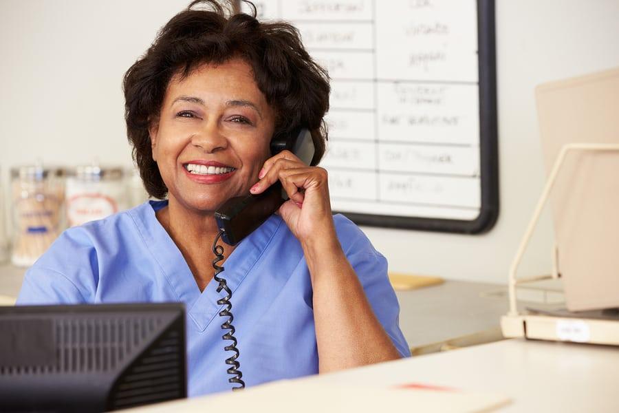 Nurse Making Phone Call At Nurses Station in Glenolden, PA