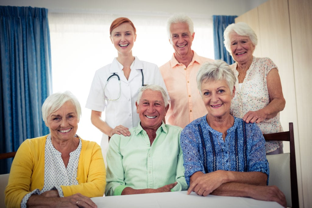 Portrait of a group of pensioners with nurse in the retirement in Glenolden, PA