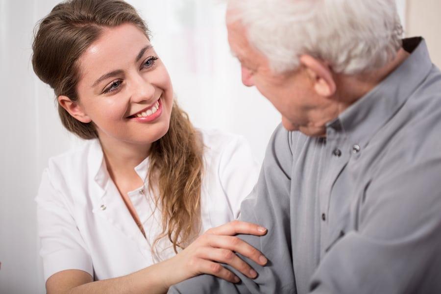 Smiling Nurse Assisting Senior Man in Berwyn, PA